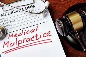 medical malpractice written in red on a paper form
