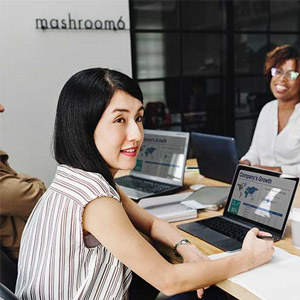 woman working on big project on laptop
