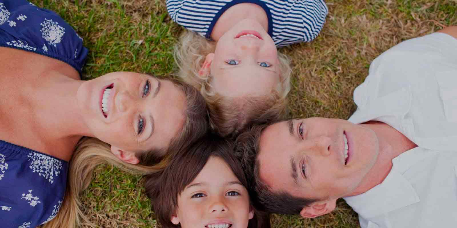 picture of family laying in the grass in a circle