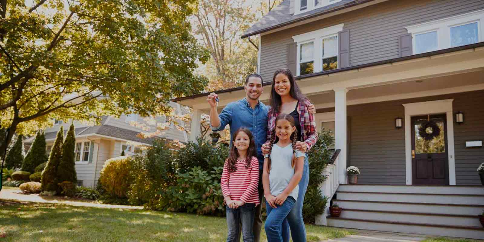 picture of family who just became new homeowners