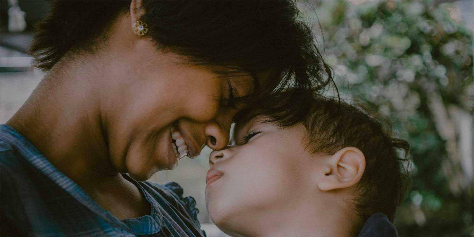 Woman caressing Child