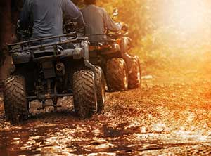 couple riding atvs covered by specialty insurance