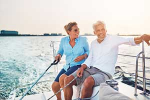 elderly couple relaxing on their boat covered by boat insurance