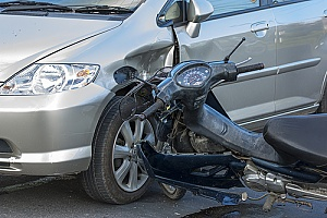 a motorcycle that crashed into a car