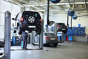 Auto shop garage with cars being repaired