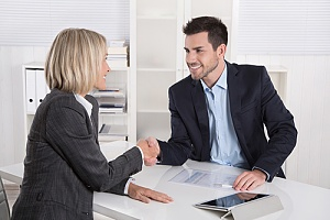 Business insurance agent making deal