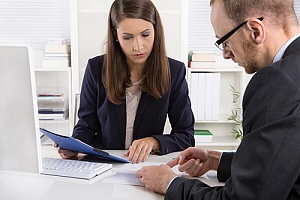 Business insurance agent looking over contract