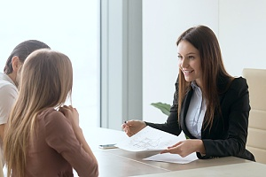 Business woman talking to people at desk
