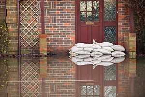 Sandbags outside of house that has personal flood insurance