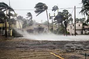 A flooded street after a catastrophic Hurricane. Flood Insurance covers homeowners from such natural disasters.