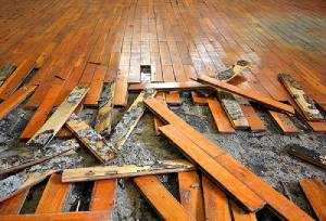 Damaged Parquet flooring tiles. Flood insurance for renters can fund replacement of items like this