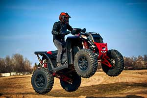 Man riding an ATV who has a personal insurance policy