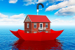 a home floating in a red umbrella on a large body of water representing flood insurance