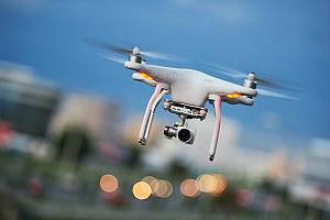 Drone with camera covered by drone insurance