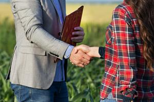 Farm and ranch insurance agent closing deal