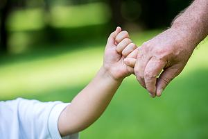 Grandparent holding grand child's hand