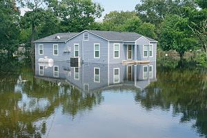 House covered with personal flood insurance after storm