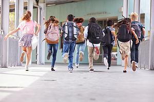 Kids running in hallway of school