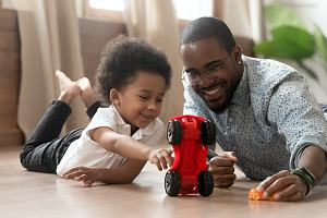 Home daycare employee with child knowing the daycare insurance cost