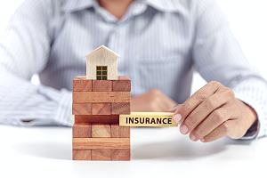 Home daycare insurance agent holding block