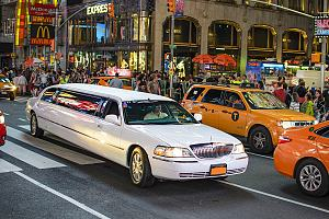 Limo with insurance driving on road
