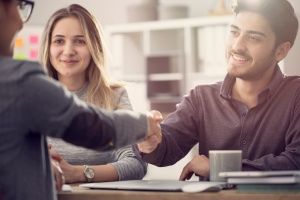 couple shaking hand of consultant after knowing What Is Personal Insurance