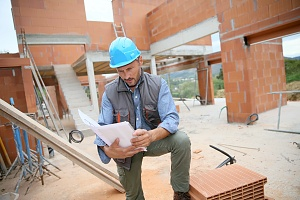 Contractor looking at his mapped out plan