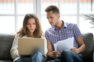couple looking at their account for personal insurance
