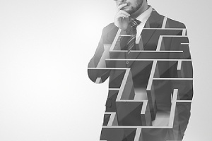 Double exposure image of a man and maze. Personal insurance can appear like a daunting, complex maze