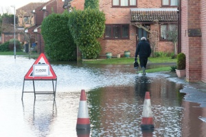person walking to work going to get Commercial Flood Insurance