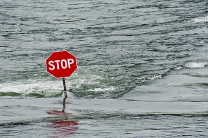 a stop sign on a street of building that have Commercial Flood Insurance
