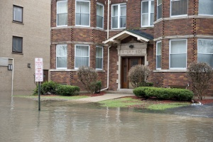 outside of a flooded building the needs Commercial Flood Insurance