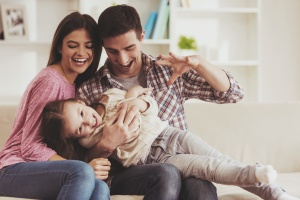 family of 3 happy because they are covered with personal insurance