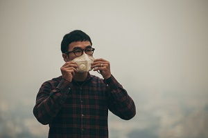 Man Wearing Mask in Pollution