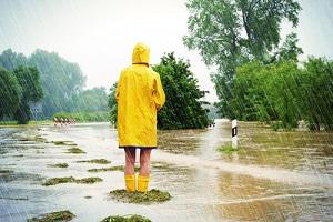 Women Standing in the Raincoat needing commercial flood insurance