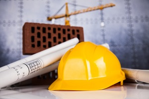buildings under construction and cranes having construction insurance