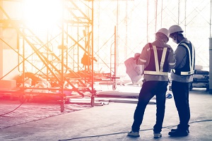 construction crews to work at building construction site course of construction insurance