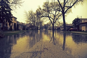 residential area after heavy flood needing commercial flood insurance