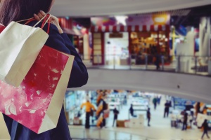 women holding bags at mall with franchise insurance