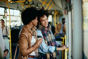 2 women on a bus with transportation insurance