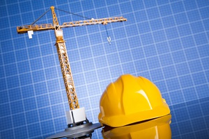 building and cranes under construction with Construction Insurance