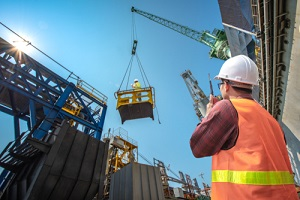 loading master connecting to gantry crane driver by walkie talkie with Construction Insurance