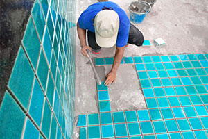 pool tiling being done with Pool And Spa Contractors Insurance