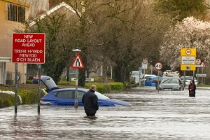 people wading through flood water on treforest industrial estate
