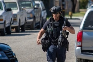 police officer during operation in california with Protective Liability Insurance