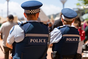 two new zealand police officers on patrol with  Police Liability Insurance